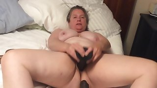 BBW ma with hairy pussy takes BBC dildo with foreskin
