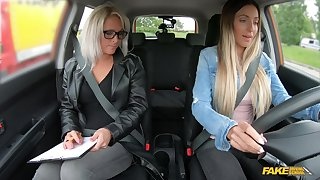 Female driving examiner shares dildo with a young chick