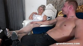 Dirty granny opens her legs to be fucked by a younger follower groupie