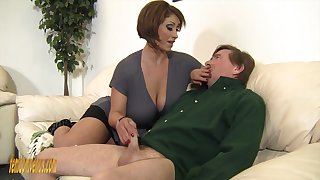 Mega busty mistress Kyle Stone gives boots labour and boobs labour to the brush submissive