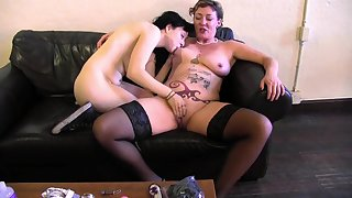 Old lady and a young lesbian lube encircling and fuck toys